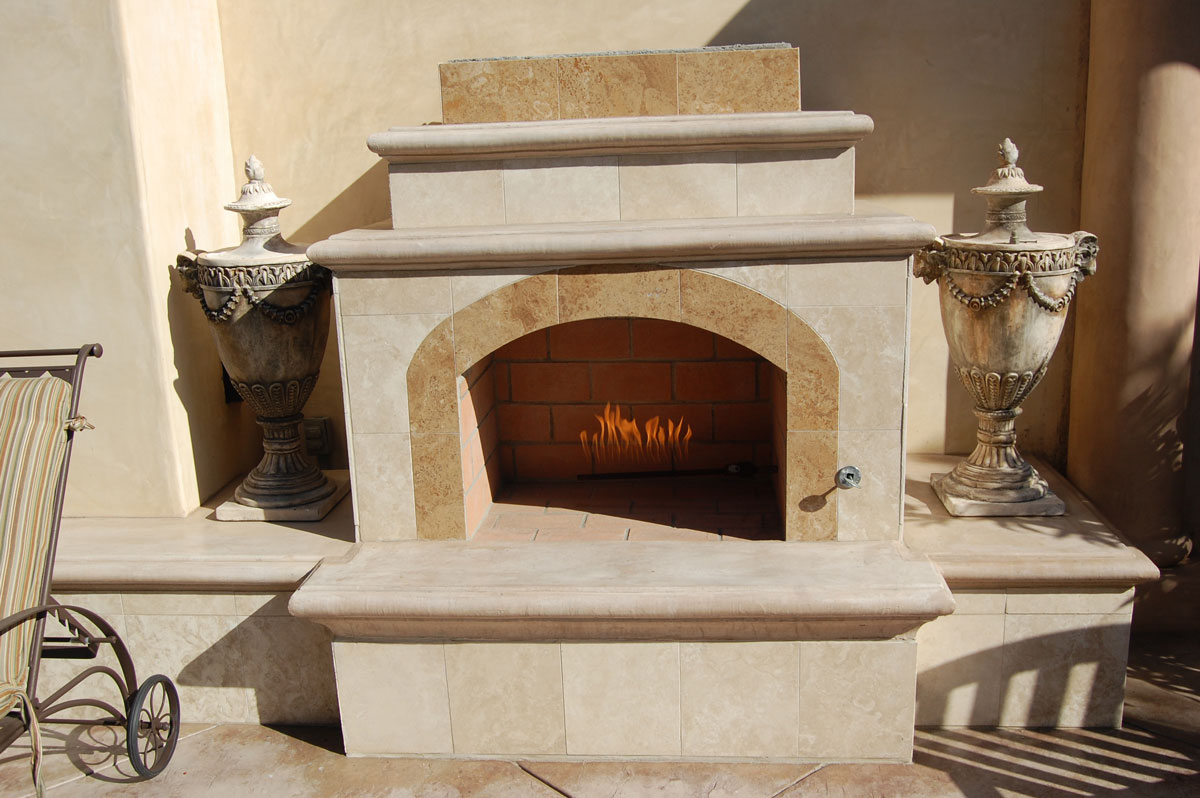 Mediterranean custom fireplace design in orange county for Mediterranean fireplace designs